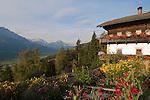 Italy, South Tyrol, Alto Adige, Dolomites, Val Pusteria, near San Candido: farmhouse with garden