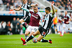 Jarred Bowen of West Ham goes past Fernandez of Newcastle. Newcastle v West Ham, August 15th 2021. The first game of the season, and the first time fans were allowed into St James Park since the Coronavirus pandemic. 50,673 people watched West Ham come from behind twice to secure a 2-4 win.