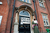On the day they lost a High Court bid to prevent closure of six Brent libraries, local residents guard Kensal Library foloowing council attempts to board the building up.