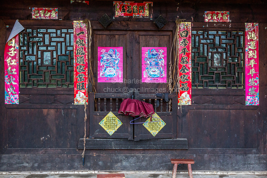 Matang, a Gejia Village in Guizhou, China.  Entrance to Private House in Village with Spring Festival (New Year) Scrolls Wishing Good Fortune, Safety, and Prosperity in the New Year.