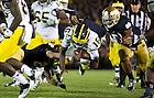 Sept. 22, 2012; Notre Dame cornerback Bennett Jackson trips up Michigan quarterback Denard Robinson during the second half.  Photo by Barbara Johnston/University of Notre Dame