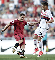 Calcio, Serie A: Roma, stadio Olimpico, 28 maggio 2017.<br /> AS Roma's Francesco Totti (l) in action with Genoa's Miguel Veloso (r) during the Italian Serie A football match between AS Roma and Genoa at Rome's Olympic stadium, May 28, 2017.<br /> Francesco Totti's final match with Roma after a 25-season career with his hometown club.<br /> UPDATE IMAGES PRESS/Isabella Bonotto