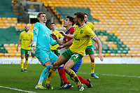 20th March 2021; Carrow Road, Norwich, Norfolk, England, English Football League Championship Football, Norwich versus Blackburn Rovers; Ben Gibson of Norwich City rolls on his ankle forcing him off with an injury