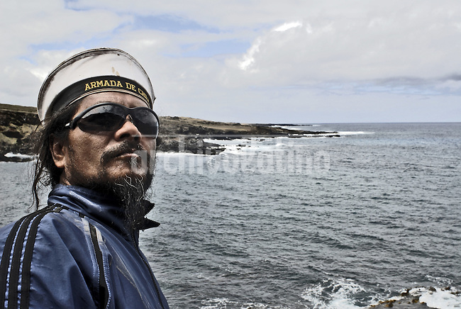 """Oct, 2007, Easter Island, Chile....German Icka Pakarati,  best known as """"Cacho"""" (47) . Fischerman, sculptor, singer and musician. He was born on Easter Island in 1960. Cacho studyng the wether After 5 days as a tourist, photographer Lorenzo Moscia set to discover the real life of one of the more surprising places of the World, mix of cultures between Oceania and Latin America, with a native population near extintion./"""