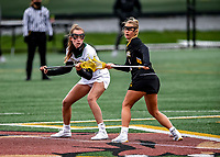 17 April 2021: University of Vermont Catamount Midfielder Jen Williams, a Junior from St. Louis, MO, faces off against UMBC Retriever Midfielder Megan Halczuk, a Sophomore from Fawn Grove, PA, at Virtue Field in Burlington, Vermont. The Lady Cats fell to the Retrievers 11-8 in the America East Women's Lacrosse matchup. Mandatory Credit: Ed Wolfstein Photo *** RAW (NEF) Image File Available ***