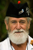 A man with a full beard waits for his pipe and drum band to play ging the Loch Norman games in Huntersville, NC.