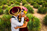 A young Mexican couple, both dressed as La Catrina, a Mexican pop culture icon representing the Death, hugs each other during the Day of the Dead celebrations in Oaxaca, Mexico, 31 October 2019. Day of the Dead (Día de Muertos), a religious holiday combining the death veneration rituals of Pre-Hispanic cultures with the Catholic practice, is widely celebrated throughout all of Mexico. Based on the belief that the souls of the departed may come back to this world on that day, people gather together while either praying or joyfully eating, drinking, and playing music, to remember friends or family members who have died and to support their souls on the spiritual journey.