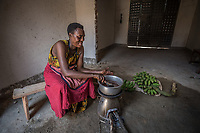 Uganda, Kakoula West. Jolly Bitature uses a Biolite stove for cooking as well solar lights in her newly rennovated home. She runs a business selling bananas.