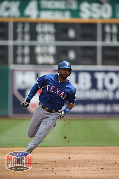 OAKLAND, CA - MAY 15:  Elvis Andrus #1 of the Texas Rangers runs the bases against the Oakland Athletics during the game at O.co Coliseum on Wednesday May 15, 2013 in Oakland, California. Photo by Brad Mangin