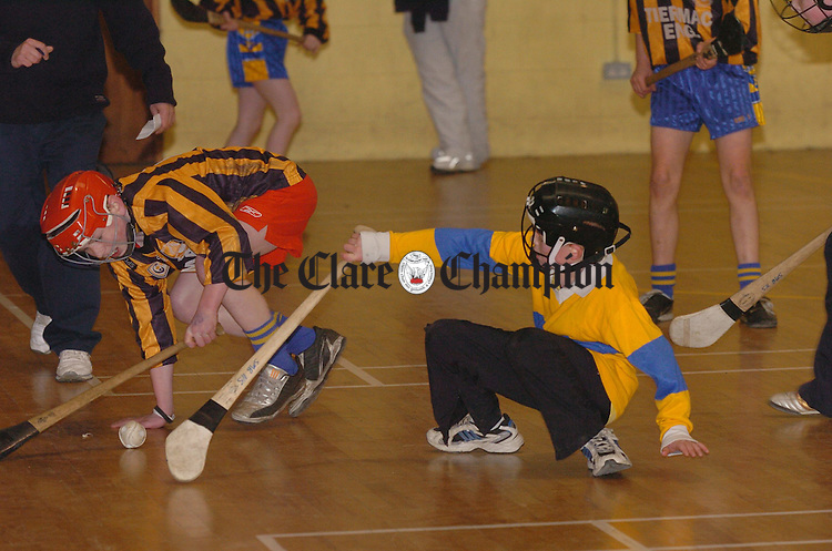 Stephan Mc Gann of Ennis CBS and Conor Deasy of Sicxmilebridge N.S. hit the deck at the schools indoor hurling final in Shannon leisure complex. Photograph by John Kelly.