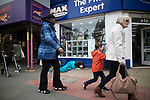 © Joel Goodman - 07973 332324 . 06/04/2017 . Manchester , UK . A woman lies slumped in front of a branch of Max Spielmann Photographic , in Piccadilly Gardens . An epidemic of abuse of the drug spice by some of Manchester's homeless population , in plain sight , is causing users to experience psychosis and a zombie-like state and is daily being witnessed in the Piccadilly Gardens area of Manchester , drawing large resource from paramedic services in the city centre . Photo credit : Joel Goodman