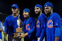 Ivan Medina (39), Eugenio Palma (86), Emilio Ferrebus (43), and Alfredo Colorado (75) celebrate with the Chuck Jared Championship Cup after defeating the AZL Giants on September 7, 2017 at Scottsdale Stadium in Scottsdale, Arizona. AZL Cubs defeated the AZL Giants 13-3 to win the Arizona League Championship Series two games to one. (Zachary Lucy/Four Seam Images)