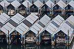 Boat condos on Burrard Inlet, Vancouver, BC, Canada, protect pleasure boats from harsh weather.