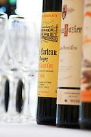 empty glasses and bottles for wine tasting saint emilion bordeaux france