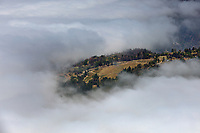 aerial photograph of fog burning off to reveal a vineyard on the western mountainside of the Napa Valley, Mayacamas Mountains, Napa County, California
