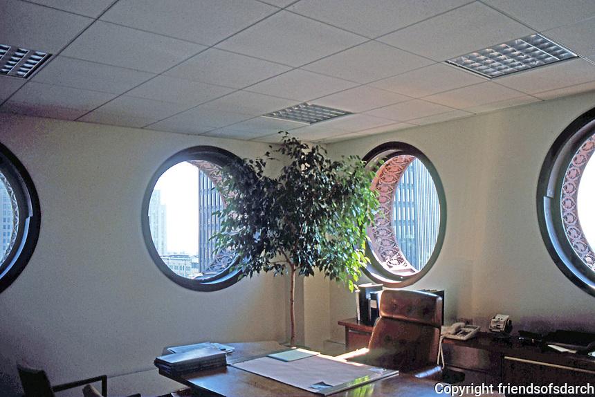 Louis Sullivan: Guaranty Bldg. Interior. 13th floor corner windows. North facing windows (left) are round. East facing (right) oval. Windows pivot open.  Photo '88.