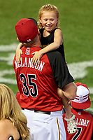 Pittsburgh Pirates Mark Melancon holds his daughter during the MLB Home Run Derby on July 13, 2015 at Great American Ball Park in Cincinnati, Ohio.  (Mike Janes/Four Seam Images)