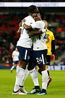 Moussa Sissoko of Tottenham Hotspur celebrates scoring his sides first goal of the match with Serge Aurier after his shot deflects off Dan Butler of Newport County during the Fly Emirates FA Cup Fourth Round Replay match between Tottenham Hotspur and Newport County at Wembley Stadium, London, England, UK. 07 February 2018