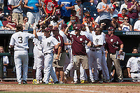 Mississippi State Bulldogs bench greets third baseman Alex Detz (3) after he scored in Game 11 at the 2013 Men's College World Series against the Oregon State Beavers on June 21, 2013 at TD Ameritrade Park in Omaha, Nebraska. The Bulldogs defeated the Beavers 4-1, to reach the CWS Final and eliminating Oregon State from the tournament. (Andrew Woolley/Four Seam Images)