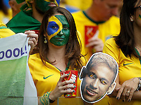 A Brazil fan looks dejected