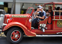 Passengers enjoy the ride on Engine 50, an antique fire engine named for Hawaii as the 50th State, on O'ahu.