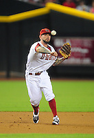 Jun. 27, 2011; Phoenix, AZ, USA; Arizona Diamondbacks third baseman Ryan Roberts makes a throw to first base against the Cleveland Indians at Chase Field. Mandatory Credit: Mark J. Rebilas-