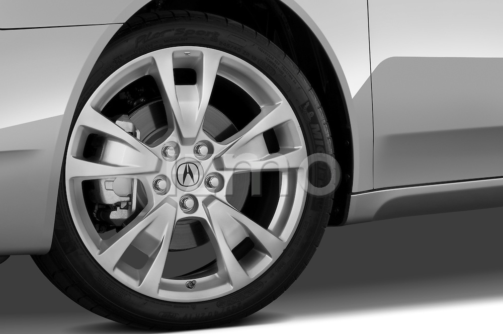 Tire and wheel close up detail view of a 2009 - 2014 Acura TL SH AWD Sedan.