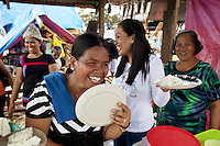 Philippines. Province Eastern Samar. Hernani. Barangay (neighbourhood) Batang. On Hernani's town festival marking the patron's saint's name, a group of women eat rice, noodles and pudding in the rubbles houses destroyed by typhoon Haiyan's winds and storm surge. 95 % of the town was destroyed by typhoon Haiyan. Typhoon Haiyan, known as Typhoon Yolanda in the Philippines, was an exceptionally powerful tropical cyclone that devastated the Philippines. Haiyan is also the strongest storm recorded at landfall in terms of wind speed. Typhoon Haiyan's casualties and destructions occured during a powerful storm surge, an offshore rise of water associated with a low pressure weather system. Storm surges are caused primarily by high winds pushing on the ocean's surface. The wind causes the water to pile up higher than the ordinary sea level. 27.11.13 © 2013 Didier Ruef