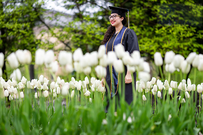 May 17, 2020; A 2020 grad takes photos at the Grotto following the online degree conferral. (Photo by Matt Cashore/University of Notre Dame)