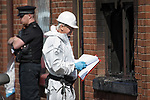 © Joel Goodman - 07973 332324 . 08/07/2017 . Bolton , UK . Forensic examiners at the scene on Rosamond Street in Daubhill , where a fatal house fire burned through a mid-terrace house this morning (Saturday 8th July 2017) . Firefighters responded at 9am this morning (Saturday 8th July 2017) . A family of five are reported to have been inside at the time and there are understand to me multiple fatalities . Photo credit : Joel Goodman