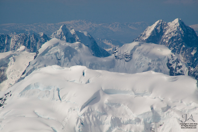 Aerial view of the Alaska Range in bright sun, looking west of Aerial view of most likely at Mount Hunter.
