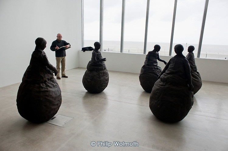 Conversation Piece III by Spanish sculptor Juan Munoz, in the Turner Contemporary gallery, Margate.