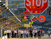 Fans walk down pit road before the start of the Bank of America 500 NASCAR race at Lowes's Motor Speedway in Concord, NC.