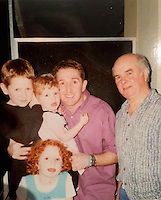 """Pictured: TV pundit Jonathan Davies (3rd L) with his step-father Ken (R) and unknown children. IMAGE TAKEN FROM JONATHAN DAVIES' SOCIAL MEDIA<br /> Re: Rugby legend Jonathan Davies has been hit by heartbreak days before his third wedding.<br /> Davies's stepfather Ken died suddenly while the BBC pundit and his new bride were getting ready for their big day.<br /> Father-of-four Davies , 53, tweeted: """"Lost a great man today. My step dad for 37 yrs. RIP Ken. Thank you for being there for me always.""""<br /> Davies and his glamorous fiancee Jay Thorburn, 40, vowed to go ahead with the wedding in Marbella, Spain, which they booked earlier this year.   <br /> A friend of the pair said: """"It was a difficult decision - Jonathan was very close to his stepdad.<br /> """"Ken and Jonathan's mother helped him bring up his children when his first wife died tragically."""