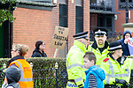 """© Joel Goodman - 07973 332324 . 03/03/2012 . Heywood , UK . A woman holds a placard reading """" No to Sharia Law """" . The National Front hold a rally in protest against an alleged paedophile ring that had been operating in the area . There is currently (3rd March 2012) a case being tried at Liverpool Crown Court in relation to the allegations . Last Thursday (23rd February 2012) a protest organised in the town in relation to the same story resulted in Asian business being attacked by an angry mob . Photo credit : Joel Goodman"""