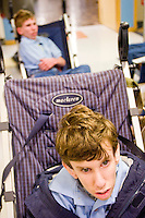 Erik Kjorling waits for a doctor at the Children's Hospital during Share and Care Network's annual retreat, held at the Doubletree Guest Suites Hotel in Boston on May 20, 2006. <br /> <br /> The Share and Care Network was created in 1981 by Pat Cahill when her son Scott was diagnosed with Cockayne Syndrome.  A rare form of dwarfism, Cockayne Syndrome is a genetically determined condition whose symptoms include microcephaly, mental retardation, progressive blindness, progressive hearing loss, premature aging, and a shortened lifespan averaging 18 years.  Those afflicted have distinctive facial features, including sunken eyes, pinched faces, and protruding jaws as well as distinctive gregarious, affectionate personalities.<br /> <br /> Because of the rarity of the condition (1/1,000 live births) and its late onset (characteristics usually begin to appear only after one year), many families and physicians are often baffled by children whose health begins to deteriorate after normal development.  It was partly with this in mind that the Share and Care Network was formed, to promote awareness of this disease as well as to provide a support network for those families affected.  In 1998 it began organizing an annual retreat, which has grown from three families in its inaugural year to more than 30 today.  Although the retreat takes place in the United States, families from as far as Japan arrive for this one weekend out of the year to share information and to support one another.