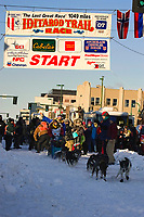 In honor of the late 4-time Iditarod champion, Susan Butcher, husband David Monson & daughters take team down 4th ave during Iditarod ceremonial start