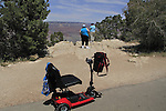 Wheelchair and two overweight women along the South Rim Trail of Grand Canyon National Park, Grand Canyon Village, Arizona. . John offers private photo tours in Grand Canyon National Park and throughout Arizona, Utah and Colorado. Year-round.