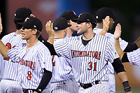 Brandon Dulin (31) of the Kannapolis Intimidators high fives his teammates after their win over the Hagerstown Suns at Kannapolis Intimidators Stadium on June 14, 2017 in Kannapolis, North Carolina.  The Intimidators defeated the Suns 10-1 in game two of a double-header.  (Brian Westerholt/Four Seam Images)