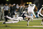 Nevada's Elijah Mitchell (28) dives at Colorado State Steven Walker (30) during the second half of an NCAA college football game in Reno, Nev., on Saturday, Oct. 11, 2014. Colorado State won 31-24. (AP Photo/Cathleen Allison)