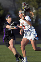 Boston College midfielder Hannah Alley (8) on the attack as University at Albany midfielder Michelle Primomo (1) defends. University at Albany defeated Boston College, 11-10, at Newton Campus Field, on March 30, 2011.