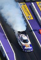 Apr. 28, 2012; Baytown, TX, USA: Aerial view of NHRA funny car driver Matt Hagan during qualifying for the Spring Nationals at Royal Purple Raceway. Mandatory Credit: Mark J. Rebilas-