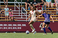 NEWTON, MA - SEPTEMBER 12: Linda Boama #13 of Boston College dribbles down the wing as Claire Carew #2 of Holy Cross defends during a game between Holy Cross and Boston College at Newton Campus Soccer Field on September 12, 2021 in Newton, Massachusetts.