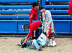 Sprint Cup Series driver Kyle Busch (18) falls off a bull at the No Limits Garage Party before the Nascar Sprint Cup Series AAA Texas 500 race at Texas Motor Speedway in Fort Worth,Texas. Sprint Cup Series driver Tony Stewart (14) wins the AAA Texas 500 race.