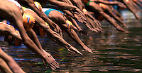 27 MAY 2012 - MADRID, ESP - Competitors dive into the water at the start of the swim at the elite men's 2012 World Triathlon Series round in Casa de Campo, Madrid, Spain .(PHOTO (C) 2012 NIGEL FARROW)