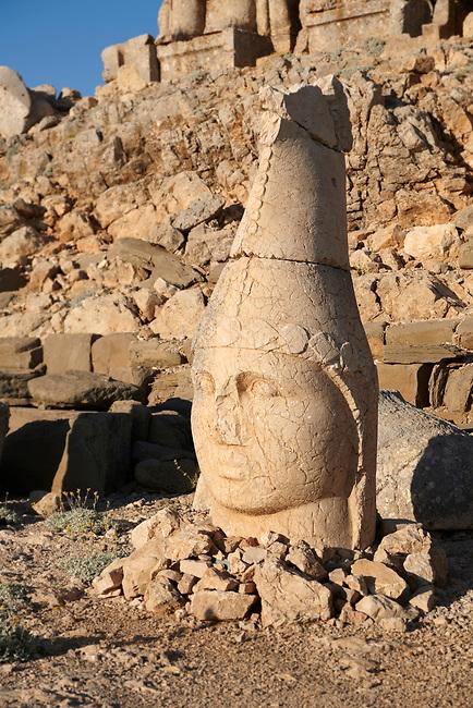 Statue head of Apollo in front of the stone pyramid 62 BC Royal Tomb of King Antiochus I Theos of Commagene, east Terrace, Mount Nemrut or Nemrud Dagi summit, near Adıyaman, Turkey