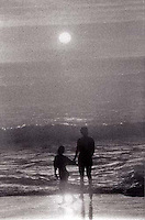 Couple by the shore at Sunset<br />