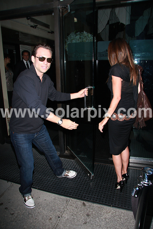 **ALL ROUND PICTURES FROM SOLARPIX.COM**.**WORLDWIDE SYNDICATION RIGHTS**.**NO PUBLICATION IN USA, DENMARK, GERMANY OR RUSSIA.Christian Slater and his girlfriend Tamara Mellon have a late night dinner at Mr. Chow Restaurant in Beverly Hills, USA. 17th August 2008..This pic: Christian Slater and Tamara Mellon..JOB REF: 7049 LAP/Lancer        DATE: 17_08_2008.**MUST CREDIT SOLARPIX.COM OR DOUBLE FEE WILL BE CHARGED* *UNDER NO CIRCUMSTANCES IS THIS IMAGE TO BE REPRODUCED FOR ANY ONLINE EDITION WITHOUT PRIOR PERMISSION*