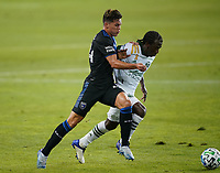 SAN JOSE, CA - SEPTEMBER 16: Cade Cowell #44 of the San Jose Earthquakes battles for the ball with Diego Chara #21 of the Portland Timbers during a game between Portland Timbers and San Jose Earthquakes at Earthquakes Stadium on September 16, 2020 in San Jose, California.