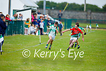 Ballyduff's Kevin Goulding in full flight as Kevin Griffin of St Michaels Foilmore gives chase in the County Senior football league.